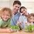 smiling family preparing a salad together in their kitchen stock photo © wavebreak_media