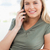 A close up shot of a woman making a call while smiling and looking in front of her. stock photo © wavebreak_media