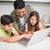 Father with kids using laptop in kitchen stock photo © wavebreak_media