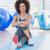 Fit woman sitting on exercise mat in fitness studio stock photo © wavebreak_media