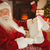 smiling santa claus reading his list stock photo © wavebreak_media