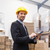 warehouse manager wearing hard hat using tablet stock photo © wavebreak_media