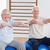 senior couple with arms raised sitting on exercise ball stock photo © wavebreak_media