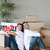 Cheerful couple with unpacking boxes moving to a new house stock photo © wavebreak_media