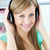 Bright caucasian woman listening to music with headphones in the kitchen at home stock photo © wavebreak_media