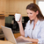 Woman drinking tea while on her laptop stock photo © wavebreak_media