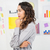 young thinking businesswoman looking at sticky notes stock photo © wavebreak_media