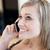 charming woman talking on phone sitting on a sofa stock photo © wavebreak_media