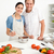 Happy couple preparing a bolognese sauce together stock photo © wavebreak_media