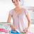 Smiling Woman ironing clothes in a utility room stock photo © wavebreak_media