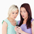 Shocked young women with a cellphone in a studio stock photo © wavebreak_media