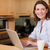 Smiling woman in the kitchen with her notebook stock photo © wavebreak_media