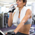 fit woman taking a drink on the exercise bike stock photo © wavebreak_media