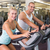 fit young couple working on exercise bikes at gym stock photo © wavebreak_media