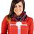 smiling brunette holding a gift with white bow stock photo © wavebreak_media
