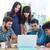 equipe · de · negócios · em · pé · trabalhando · laptop · juntos · escritório - foto stock © wavebreak_media