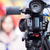 video camera in the focus blurred female reporter in the backgr stock photo © wellphoto