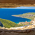 komiza bay aerial view through stone window stock photo © xbrchx