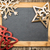 christmas tree decorations on vintage wooden blackboard stock photo © yaruta