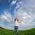 mutlu · çocuk · atlama · yeşil · alan · mavi · gökyüzü - stok fotoğraf © Yaruta