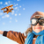 Happy kid playing with toy airplane in winter stock photo © Yaruta