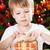 menino · abertura · apresentar · surpreendido · árvore · de · natal - foto stock © Yaruta