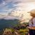 girl tourist on mountains at sunset stock photo © yongkiet