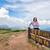 turista · menina · adolescente · montanha · andarilho · desgaste · boné - foto stock © Yongkiet