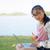 dziewczyna · notebooka · wody · działalności · komputera · trawy - zdjęcia stock © yongkiet
