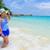bella · donna · spiaggia · Thailandia · blu · strisce · costume · da · bagno - foto d'archivio © Yongkiet