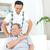 アジア · 家族 · 歳の男性 · 肩の痛み · 座って · ソファ - ストックフォト © yongtick