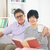 senior asian couple reading a book together at home stock photo © yuliang11