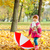 A little girl walking in the park with an umbrella stock photo © zeffss