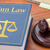 a law book with a gavel   gun law stock photo © zerbor
