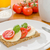 crispbread with tomato and mozzarella on a breakfast table stock photo © zerbor