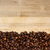 a pile of coffee beans forming a simple stripe frame stock photo © zhukow