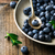 fresh blueberry in to the vintage metal plate stock photo © zoryanchik