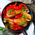 chicken drumsticks with a pepper in a frying pan stock photo © zoryanchik