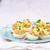 delicious stuffed eggs on blue plate stock photo © zoryanchik