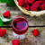 liqueur from raspberry in a shot glass stock photo © zoryanchik