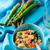asparagus and shrimp risotto in blue dish stock photo © zoryanchik