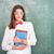 boldog · iskolás · lány · tart · tankönyvek · iskolatábla · háttér - stock fotó © zurijeta
