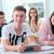 smiling student sitting with classmate stock photo © zurijeta