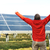 success engineer in solar panel fields opening arms up stock photo © zurijeta