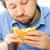 fiatal · éhes · férfi · eszik · szendvics · iroda - stock fotó © zurijeta