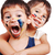 two little cute brothers with colors on their faces stock photo © zurijeta