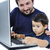 father and son on laptop stock photo © zurijeta