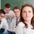 mosolyog · iskolás · lány · gondolkodik · iskolatábla · iskola · diák - stock fotó © zurijeta