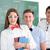 smiling schoolgirl with two classmates stock photo © zurijeta