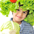 beautiful little kid with tomato and salad hat on his head holding cabbage stock photo © zurijeta